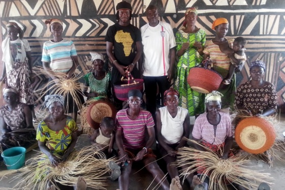 Fuseini and his father Abubakari with some of the weavers in the sommunity center.