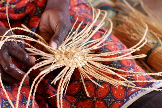 The weaving process starts at the base of the basket.