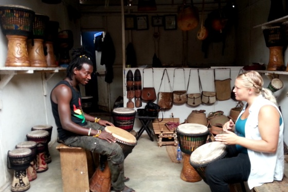 Fuseini with a drum student in the shop in the Art Market in Accra.