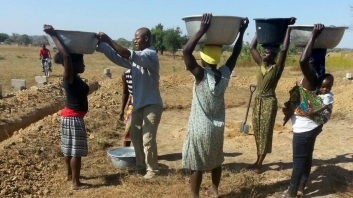 LOF - women carry water for building